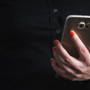 Image of a woman holding a mobile phone