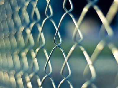 Image of a chain link fence to suggest security