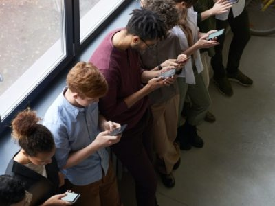 Photo of several people using their mobile phones