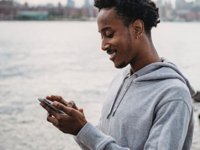 Man using his mobile phone and smiling